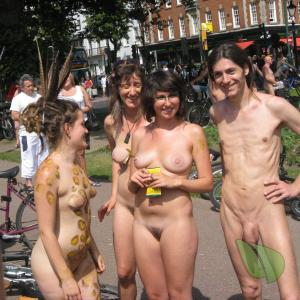 a group of nude people staying active out and about