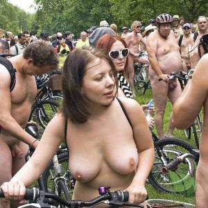 a crowd of nude people getting competitive in the woods