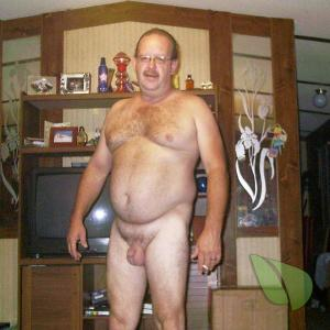 Solo nudist in their home