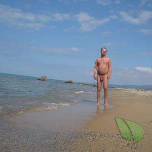 Solo nudist in the sand