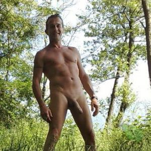 One nudist enjoying nature in the woods