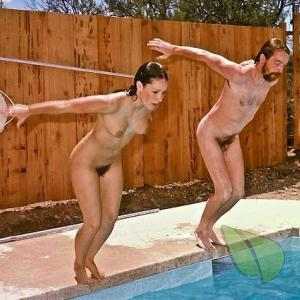 A naturist staying fit hanging out in the pool