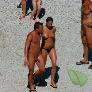 One nude couple playing on the playa