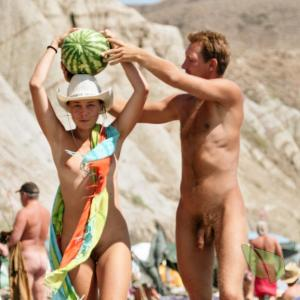 A nudists dressing up outdoors