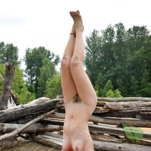 A woman does yoga in nature