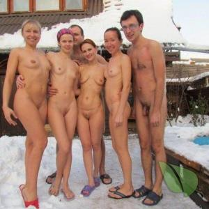 a bunch of nudists sitting at home outdoors