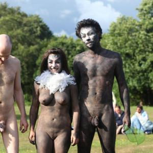 a group of nude person in the wilderness