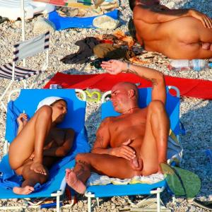 One nudist couple showing off their tats outdoors