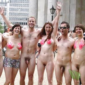 some nude people wearing fun bodypaint in the wilderness