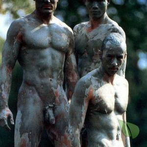 some guys wearing fun bodypaint in the woods