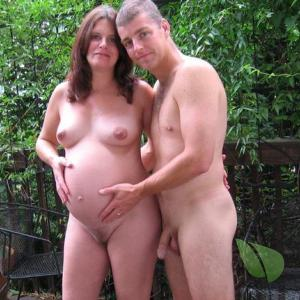 A nudist couple having fun at home in the woods