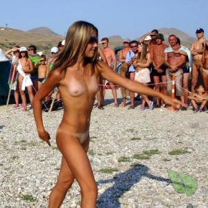a crowd of nude people in the wilderness