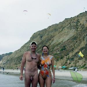 A nudist wearing fun bodypaint out and about