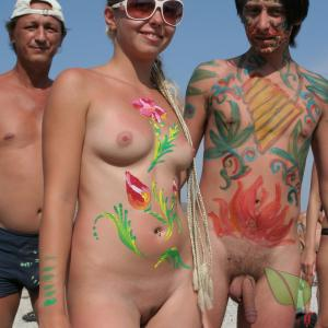 a bunch of naturists wearing fun bodypaint out and about