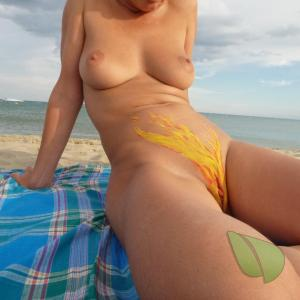 Solo female covered in bodypaint in nature