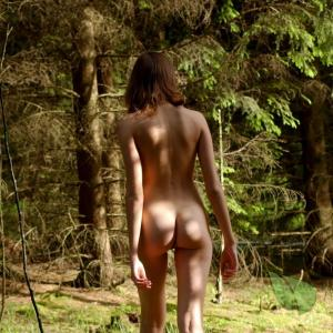A woman enjoying nature in the woods
