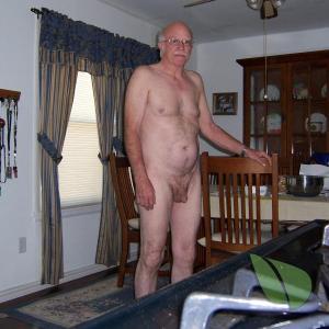 One nudist posing in their house