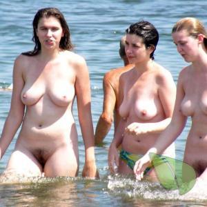 a bunch of ladies splashing around in the wilderness