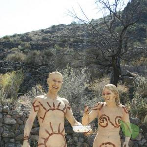 Solo nudist rocking bodypaint in nature