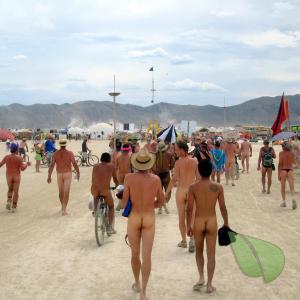 a group of naturists with cool tattoos near the woods