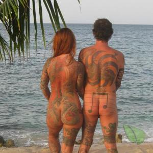 Solo nudists all tattooed up in the wilderness