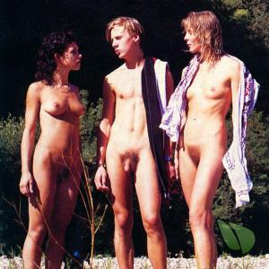 a crowd of co-ed nudists outdoors