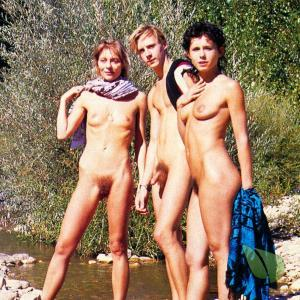 a bunch of nude person in the wild