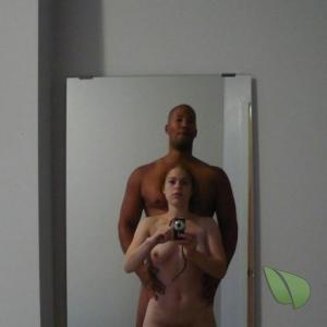 A nudist couple relaxing at home