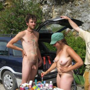 Solo female covered in bodypaint in the wilderness