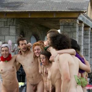 a couple co-ed nudists outside