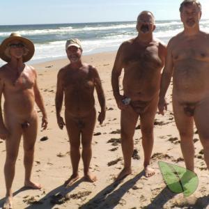 a crowd of guys enjoying the sun
