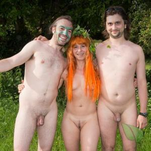 a bunch of nudists all tattooed up near the woods