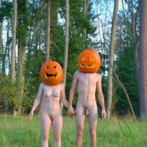 A nudist couple ready for halloween outdoors