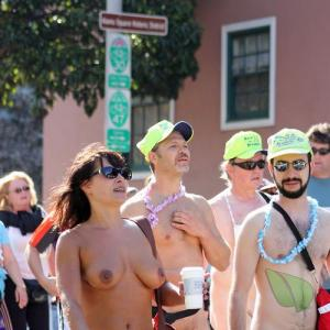 a crowd of naturists in a costume on a trail