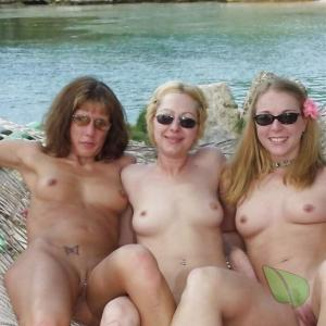 a group of friends relaxing in the water in the wilderness