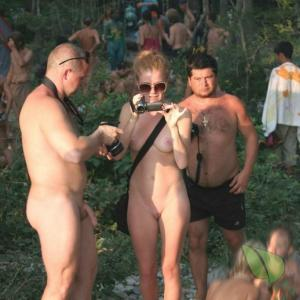 some nudist getting painted outside