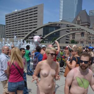 a crowd of nudists outside