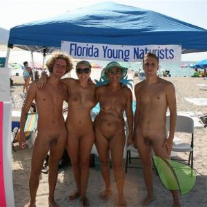 a group of nudist in the surf