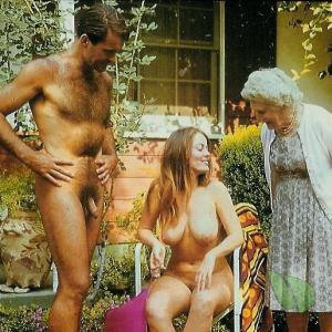 Solo nudist couple posing in their house outside
