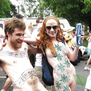 A nudist couple getting painted outside