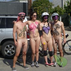 a couple co-ed nudists dressing up outdoors