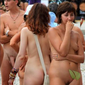 a crowd of nudist outside