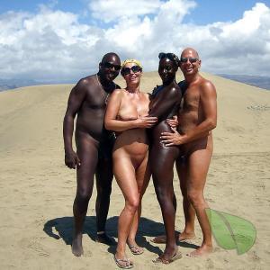A nudist couple outside
