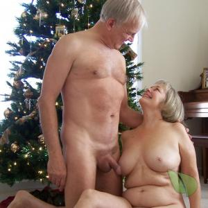 A nudist couple posing in their house