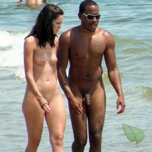 A nude couple showing off their tats out and about