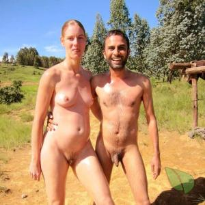 A Nudists Sitting At Home In Nature