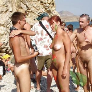 a bunch of nudists splashing around in nature