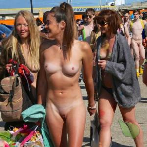 some nude people being bodypainted in the wilderness