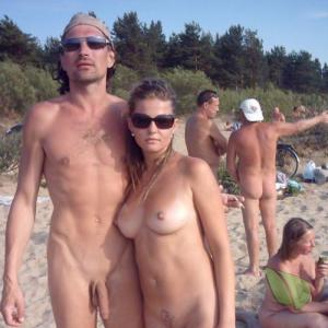 a bunch of naturists showing off their tats outdoors