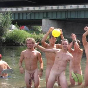 a crowd of men enjoying the water outside